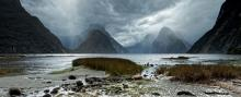 A burst of sunshine breaks through a relentlessly rainy day at Milford Sound.