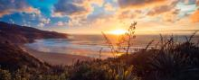 The sun sets over Ngarunui Beach, Raglan's main beach