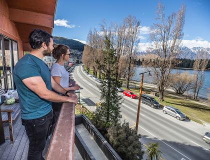 YHA Queenstown Lakefront interior balcony people 201709 6984 2500